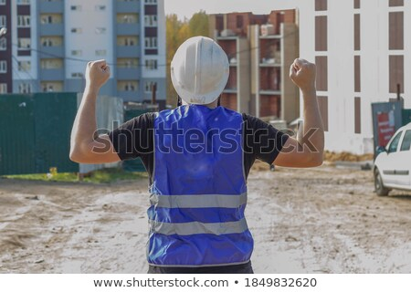 Architect with his fist on a hard hat Stock photo © photography33