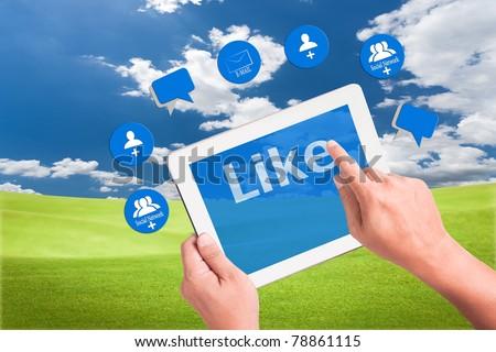 Hand Pressing Like Button In Tablet Pc Stok fotoğraf © SuriyaPhoto