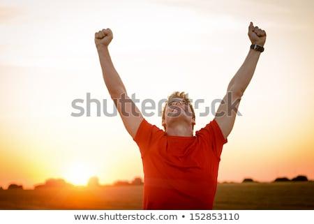 Glimlachend man vieren succes armen omhoog Stockfoto © wavebreak_media