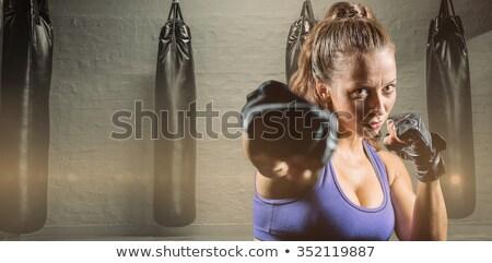 Crossfit nő box piros homokzsák fitnessz nő Stock fotó © lunamarina