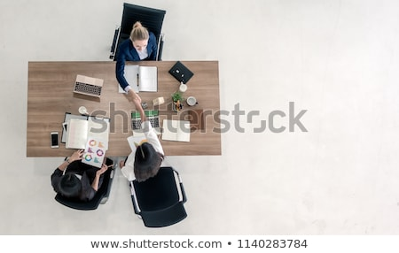 businesswoman with copy space in hands stock photo © lunamarina