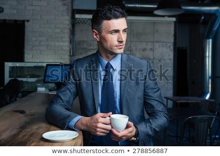 Thoughtful mature businessman in suit Stock photo © ozgur