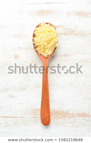 Grated cheese on spoon stock photo © Digifoodstock