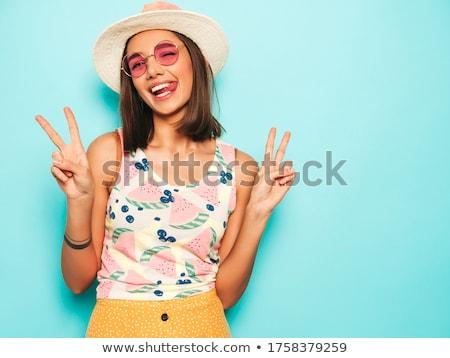 Uśmiechnięty brunetka hat okulary kobieta szczęśliwy Zdjęcia stock © wavebreak_media