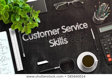 Customer Service - Text on Black Chalkboard. 3D Rendering. Stock photo © tashatuvango
