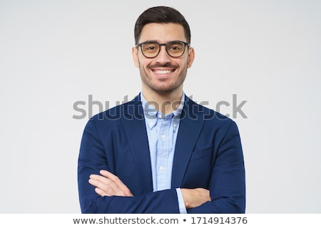 young casual man holding jacket looks up stock photo © feedough