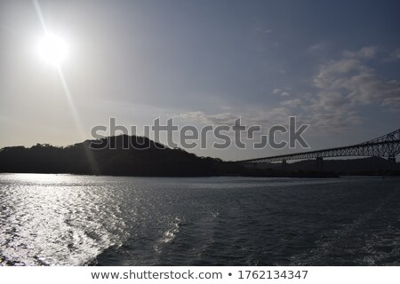 canal of panama with cloudy sky at sunset stock photo © diego_cervo