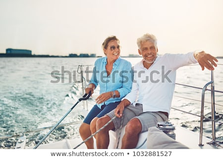 glimlachend · paar · vergadering · jacht · dek · vakantie - stockfoto © is2