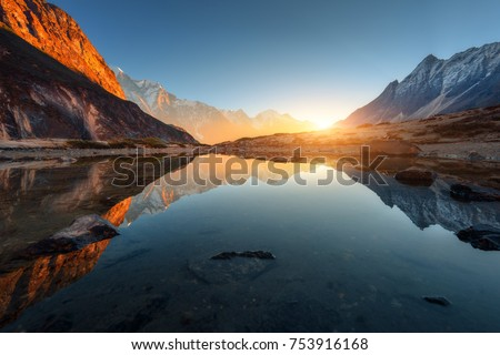 Sunset at the lake with sky reflecting in water Stock photo © MikhailMishchenko