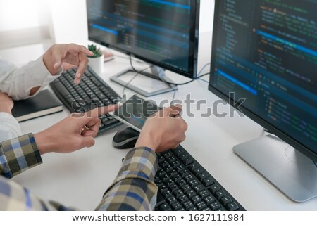 Pensive programmer working on on desktop pc programming code tec Stock photo © snowing