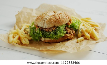 Chicken burger lying on parchment Stock photo © dash