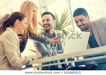 Gülen iş adamları çalışmak ofis iş kadın Stok fotoğraf © Minervastock