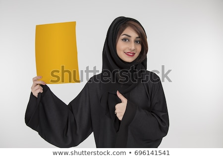 Arab business woman holding sign or banner isolated on white bac Stock photo © NikoDzhi