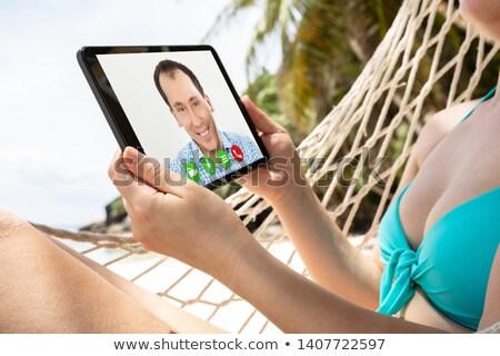 若い女性 ハンモック ビデオ 呼び出し デジタル タブレット ストックフォト © AndreyPopov