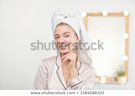 Healthy young woman with toothy smile enjoying refreshening procedure Stock photo © pressmaster