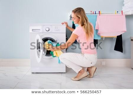 Kadın çamaşır makinesi temizlik elbise mutfak genç Stok fotoğraf © AndreyPopov