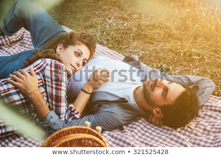Stock photo: Couple lying in the leaves