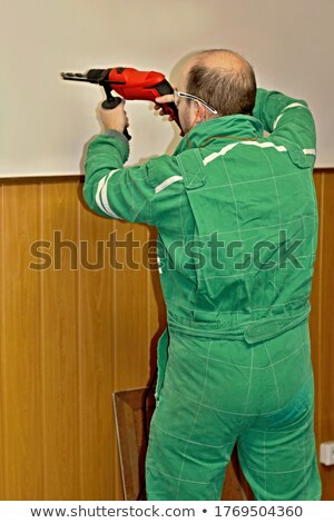 grey haired handyman drilling into wall stock photo © photography33