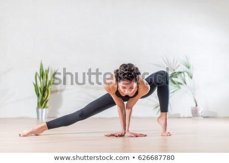 ballet dancer doing stretching stock photo © phbcz