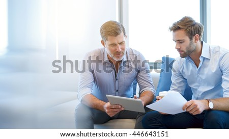 two young businessmen sitting on a couch Stock photo © photography33