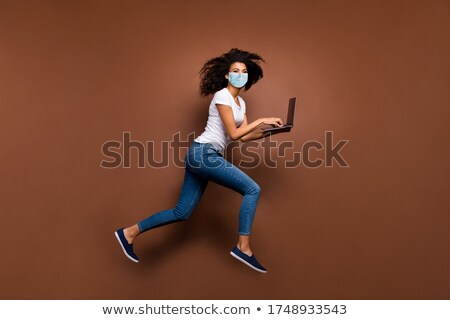 Woman protecting her laptop Stock photo © photography33