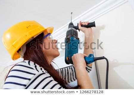 Closeup of smiling lady with electric drill Stock photo © photography33