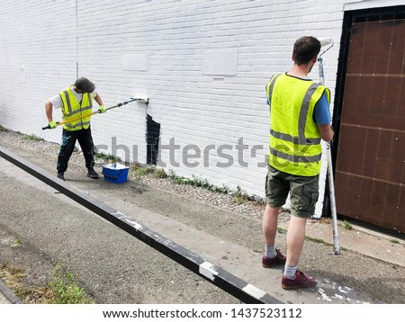 two painters back to back stock photo © photography33