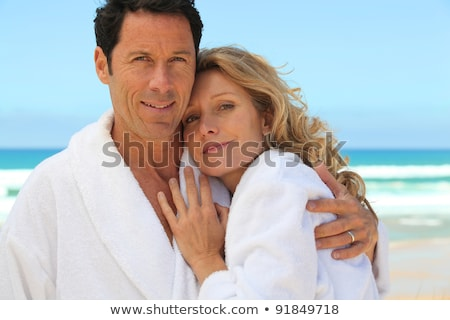mid aged couple wearing a bathrobe near the sea Stock photo © photography33