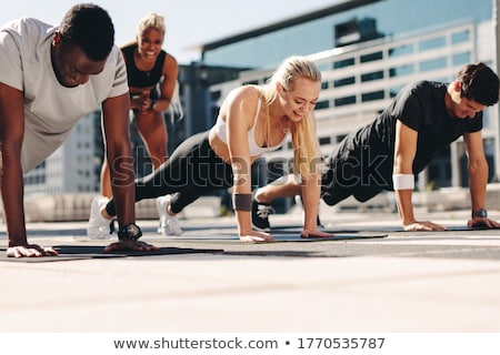young man and woman doing their workout Stock photo © photography33