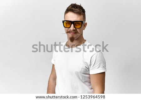 handsome fashion man with tinted sunglasses posing smiling Stock photo © feelphotoart