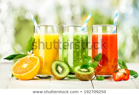 Tasty fruit juices at a market Stock photo © elxeneize
