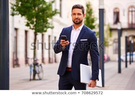 businessman looking at his smartphone stock photo © wavebreak_media