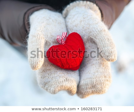 female hand with toy heart stock photo © dmitroza