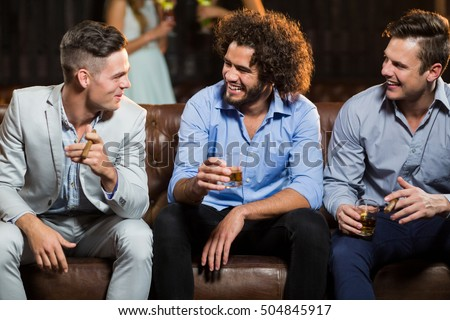 Friends interacting with each other in restaurant Stock photo © wavebreak_media