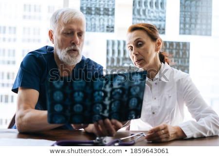 Homme infirmière xray rapport patient Photo stock © wavebreak_media