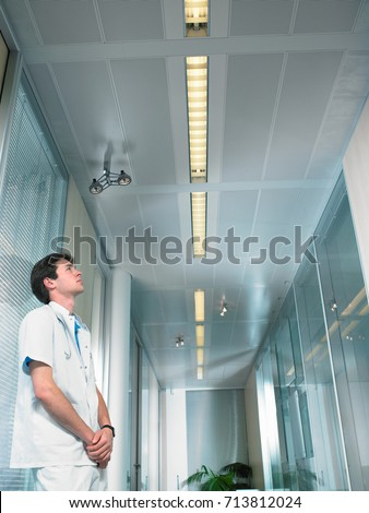 Concerned young doctor in a lobby Stock photo © IS2