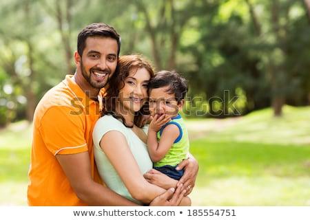 Père regarder caméra bébé ciel clôture Photo stock © IS2