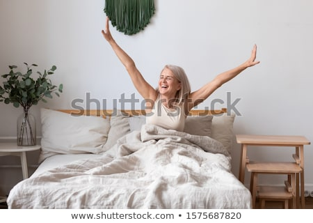 woman stretching in bed after wake up concept for holidays and vacations winter scenery flat vect stock photo © makyzz
