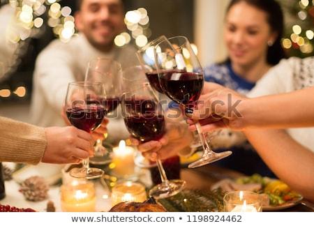 close up of friends with wine celebrate christmas Stock photo © dolgachov