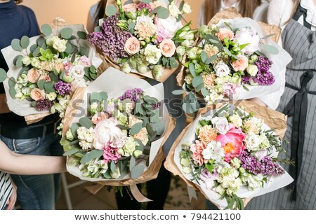Girl finishing to arrange bouquet Stock photo © pressmaster
