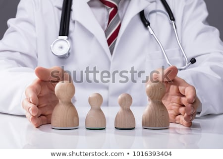 Couple's Hand Protecting Wooden Pawn Family Stock photo © AndreyPopov