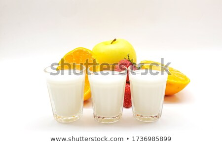 Stock photo: three cold citrus fruit milkshakes from top