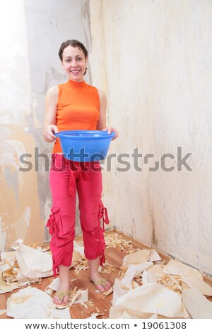 Girl with basin of water makes room renovations Stock photo © Paha_L