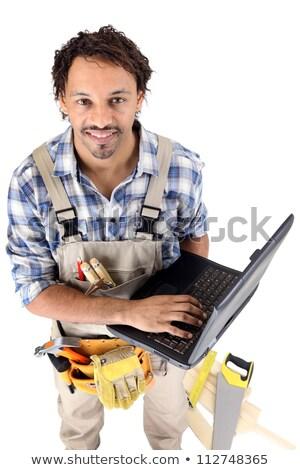 плотник ноутбука здании строительство тело инструменты Сток-фото © photography33