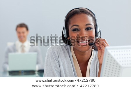 Radiant businesswoman talking with an headset Stock photo © wavebreak_media