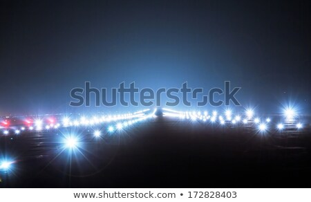 Airport approach landing direction light with airplane Stock photo © leungchopan