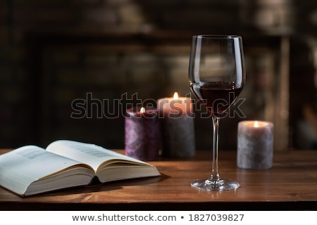 Red Wine with candles on wood table Stock photo © phila54