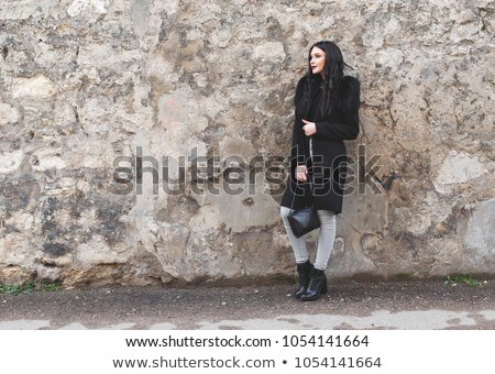 Long-haired young woman at old stone wall Stock photo © maros_b