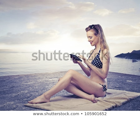Woman in Bath Towel Looking at Tablet Computer Stock photo © dash