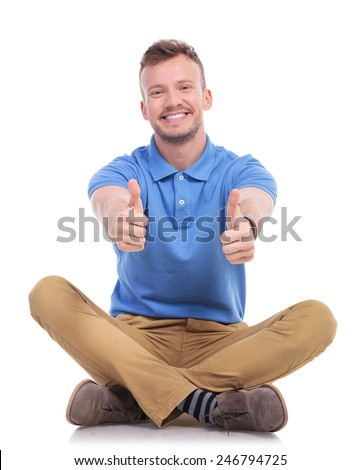 fashion man sitting andz showing thumbs up gesture stock photo © feedough